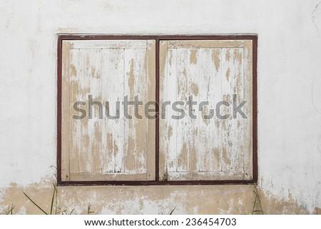yellow wooden window on wall - stock photo