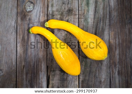 Yellow zucchini on wood - stock photo