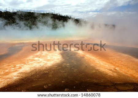 Yellowstone Grand Prismatic Spring showing animal prints - stock photo