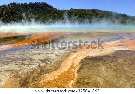 Yellowstone National Park is a volcanically active area, filled with geothermal activity of steam vents, hot springs and geysers, such as the Grand Prismatic Spring - stock photo