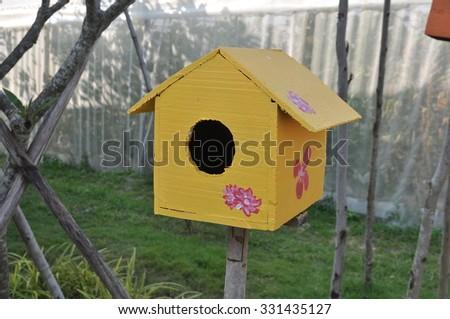 Yelolow bird box,  bird house - stock photo
