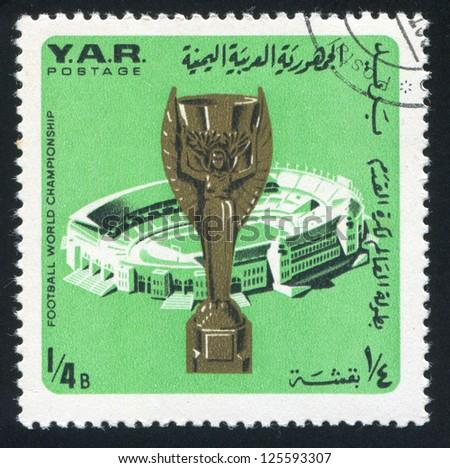 YEMEN - CIRCA 1976: stamp printed by Yemen, shows Jules Rimet Cup and stadium, circa 1976 - stock photo
