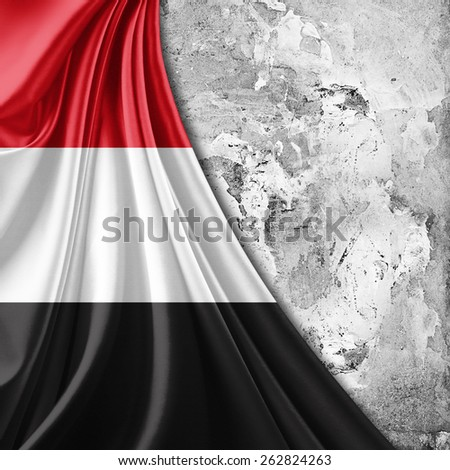 Yemen flag and wall background - stock photo