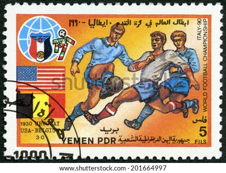 YEMEN PDR - CIRCA 1990: A stamp printed in Yemen PDR shows Soccer game, US, Belgium, 1930, History of World Cup Soccer Championships, circa 1990 - stock photo