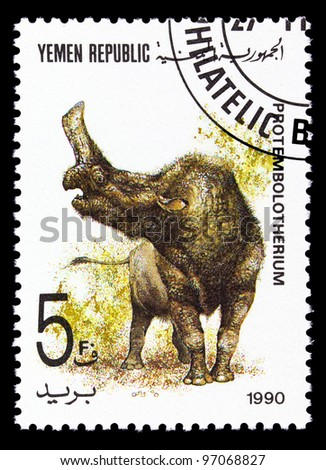 YEMEN REPUBLIC - CIRCA 1990: A stamp printed in Yemen shows Protembolotherium, series devoted to prehistoric animals, circa 1990. - stock photo