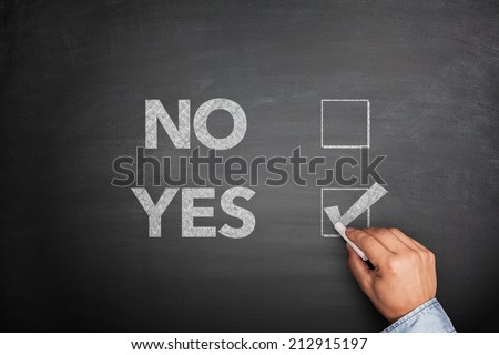 Yes or No, two choices written on the blackboard - stock photo