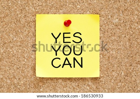 Yes You Can handwritten on yellow sticky note. - stock photo