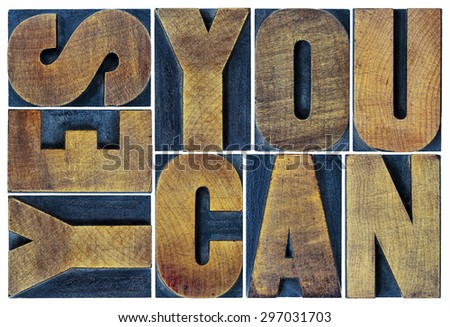 Yes you can - motivational slogan - isolated text in vintage grunge letterpress wood type printing block, rectangular layout - stock photo