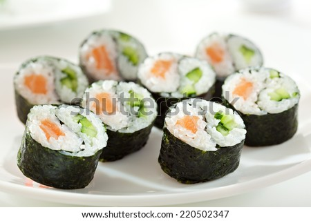 Yin Yang Maki Sushi - Roll made of Fresh Salmon and Cucumber inside. Nori Outside - stock photo