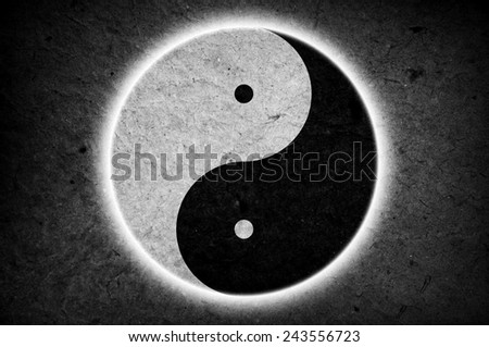 Yin Yang sign on papery background - stock photo