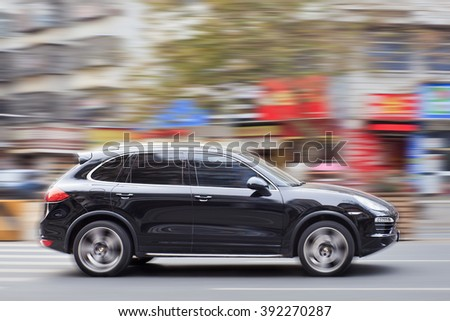 YIWU-CHINA-JAN. 15, 2016. Black Porsche Cayenne. Since 2010, Porsche has tripled sales in China. But After government crackdown on graft and conspicuous consumption, the luxury-car sales is slowing. - stock photo