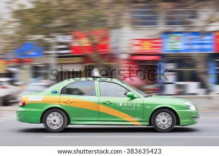 YIWU-CHINA-JAN. 20, 2016. Hyundai Sonata taxi. Taxi drivers all over the world love Hyundai. In China, there are many Elantra and Sonata taxi cars. Hyundai opened a taxi cars plant at Beijing in 2002. - stock photo