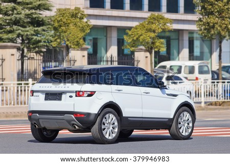 YIWU-CHINA-JAN. 26, 2016. License-plate less Range Rover Evoque. China has tons of license-plate less black windows cars driving around, breaking laws. They often behave like they are above the law.  - stock photo