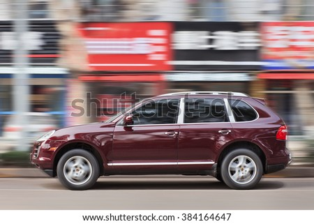 YIWU-CHINA-JAN. 19, 2016. Purple Porsche Cayenne. Since 2010, Porsche has tripled sales in China. But After government crackdown on graft and conspicuous consumption, the luxury-car sales is slowing. - stock photo