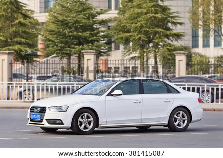 YIWU-CHINA-JAN. 26, 2016. White Audi A4 sedan. China alone forms almost one-third of Audi's sales volume, and the German car-maker holds the dominant position in the country's premium vehicle market. - stock photo