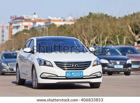 YIWU-CHINA-JAN. 25, 2016. White Hyundai Sonata. Hyundai and its affiliate Kia, which aims sell over 8 million cars in the global market, have been hit by the China shock since the beginning of 2016.  - stock photo