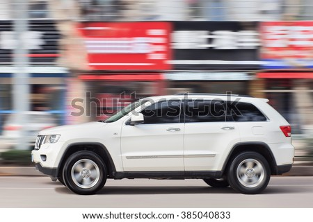 YIWU-CHINA-JAN. 19, 2016. White Jeep Cherokee. Jeep sticks to its plan to expand production in China with two more sport utility vehicles locally built this year amid market turmoil in the country. - stock photo