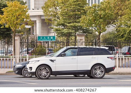 YIWU-CHINA-JAN. 26, 2016. White Range Rover sport. Jaguar Land Rover posted a 24% sales drop in China, caused by a sharp economic slowdown and government crackdown on extravagant official spending.  - stock photo