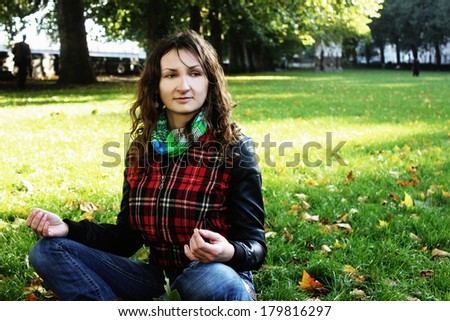 Yoga and meditation outdoor or Meditating outside - stock photo