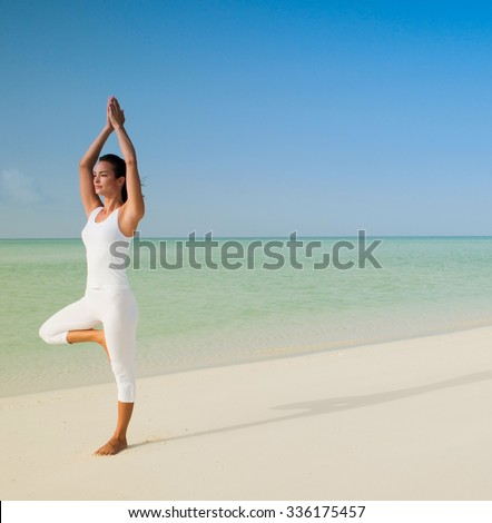 yoga beach woman doing pose - stock photo