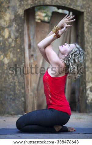 Yoga / Beautiful yoga position at the streets of India. - stock photo