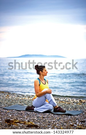 Yoga by the ocean - stock photo