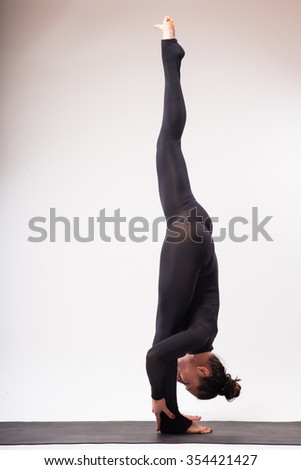 Yoga concept/Young beautiful yoga female posing on a studio background - stock photo