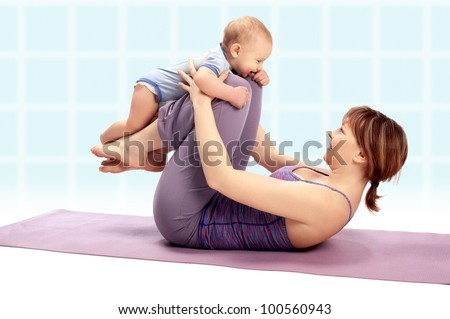 Yoga for woman and child / Mother with her baby boy doing Yoga exercises - stock photo
