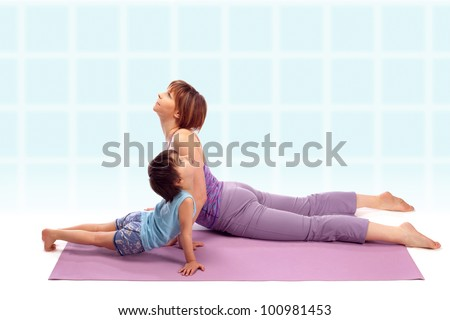 Yoga for woman and child / Mother with her son doing yoga exercise - stock photo