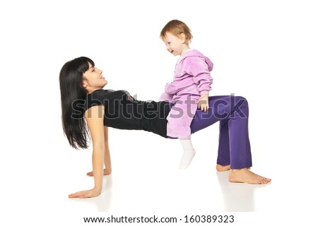 Yoga for woman and child. Mother with the baby doing exercises - stock photo