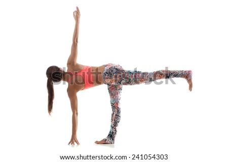 Yoga girl on white background in parivritta ardha chandrasana (Revolved Half Moon Pose) - stock photo