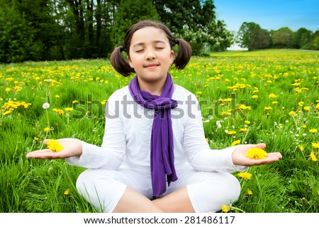 Yoga Girl - school girl in a place of silence, peace, meditation, prayer and retreat - stock photo
