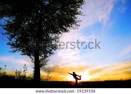 yoga in sunset - stock photo
