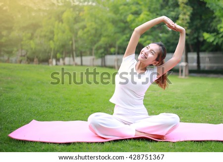 Yoga in the park, outdoor, health woman, Yoga woman. Concept of healthy lifestyle and relaxation. - stock photo