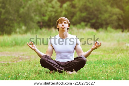 Yoga man relaxation outdoors - stock photo