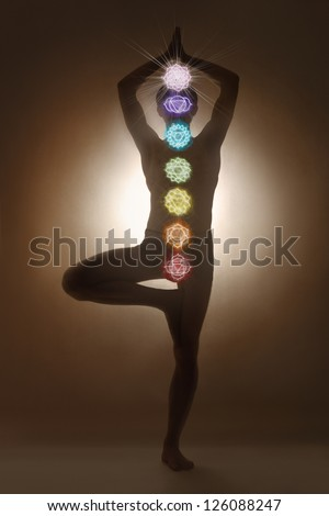 Yoga man standing, chakra symbols - stock photo