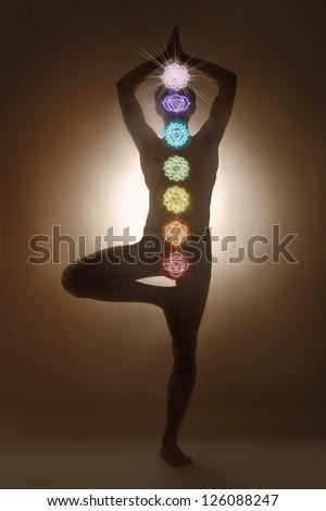 Yoga man standing, chakra symbols - stock photo
