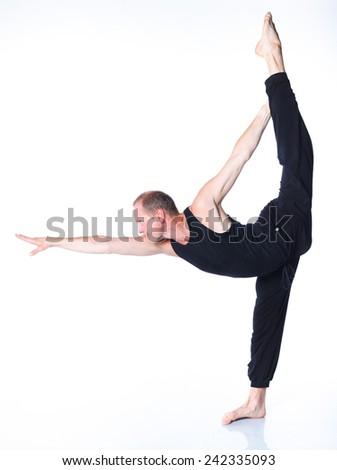 Yoga man. Young and handsome man doing yoga. On white background - stock photo