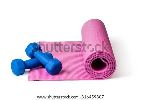 Yoga mat and dumbbells Isolated on white background - stock photo