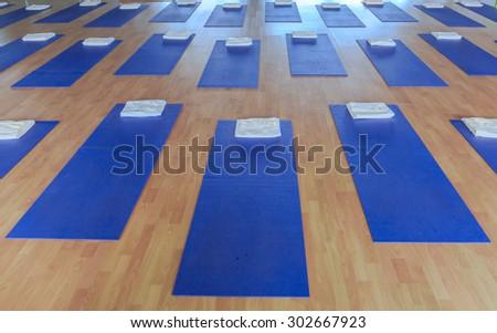 yoga mat on the wood floor - stock photo