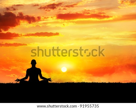 Yoga meditation in lotus pose by man silhouette at sunset sky background. Free space for text and can be used as template for web-site - stock photo