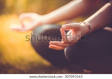 Yoga meditation in park, healthy female in peace, soul and mind zen balance concept. Selective focus and shallow DOF. Toned picture - stock photo