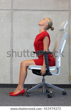 yoga on chair in office - business woman exercising  - stock photo