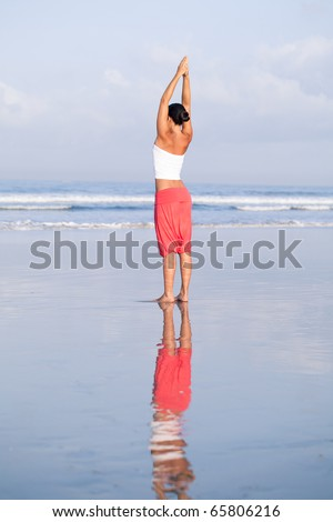 Yoga on the beach - stock photo