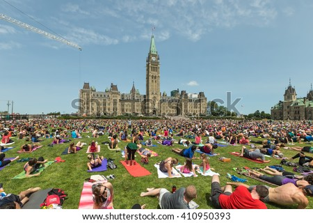 Yoga Participants on Parliament Hill, Ottawa, Ontario Canada May 18, 2015 - stock photo