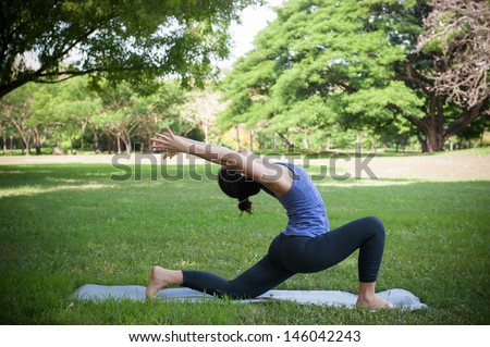 yoga pose in park - stock photo
