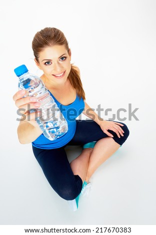 yoga pose . woman show bottle of water in front . white background isolated . - stock photo