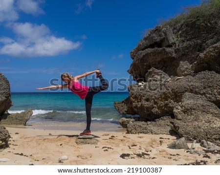 Yoga positions on a  Beach on Curacao a Caribbean Island in the Dutch Antilles - stock photo