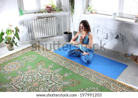 Yoga practice or Yoga at home, a Beautiful young woman doing yoga - stock photo