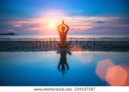 Yoga, silhouette of meditating woman. - stock photo